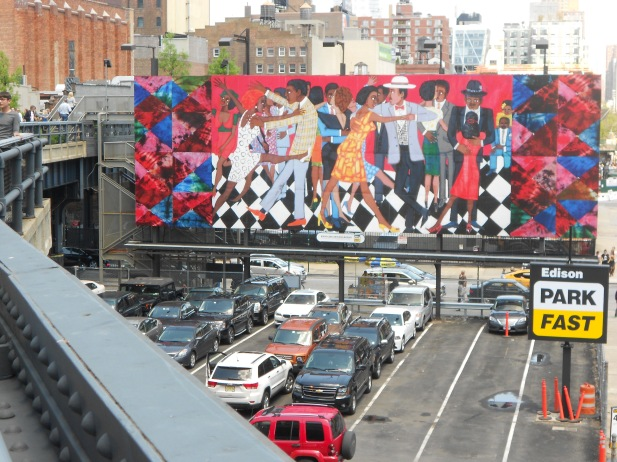 Walking across the High Line, a former subway rail, above a parking lot