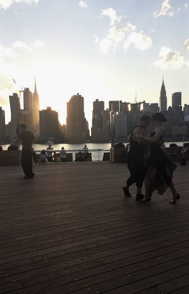Dancing, Long Island City, view of Chrysler and Empire State buildings