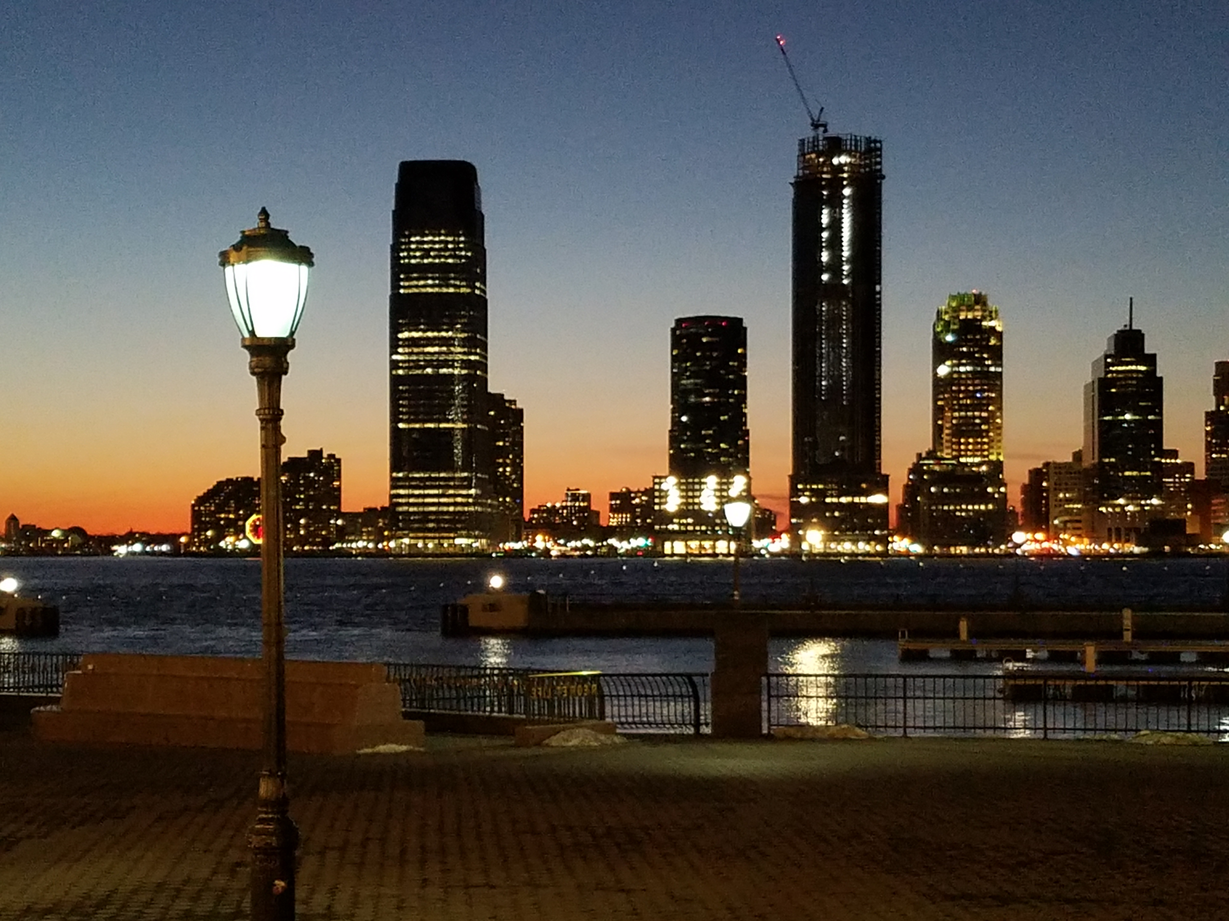 a view of the Jersey City skyline from Manhattan at sunset photo by LensMoments - Nichole Spates 2019