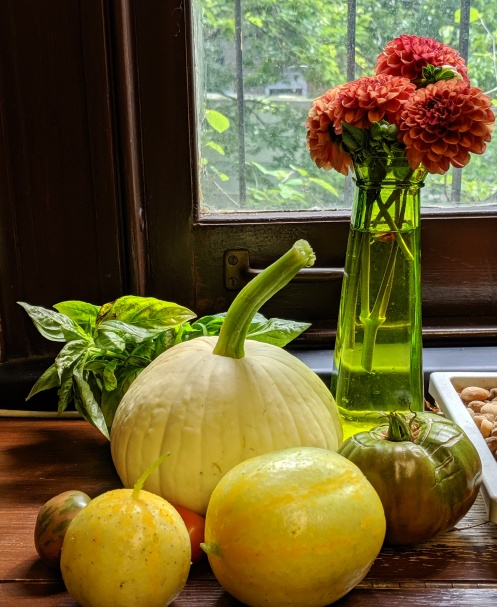 still life photography, summer vegetables and flowers in a window sill, photo by LensMomentsNS August 2019