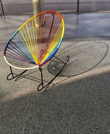 Rainbow chair with moody shadows