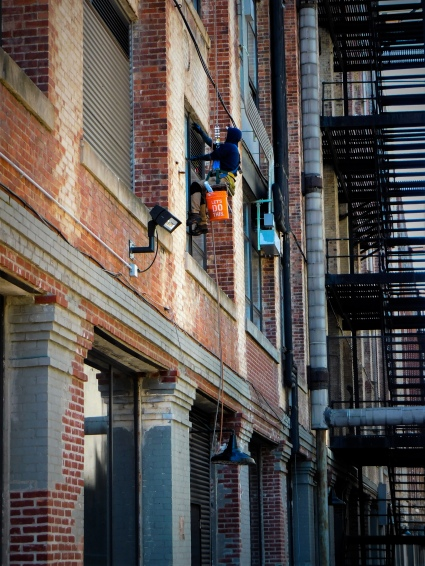 a photo of a window washer at work in industry city, brooklyn, ny by LensMomentsNS - Nichole Spates 2019