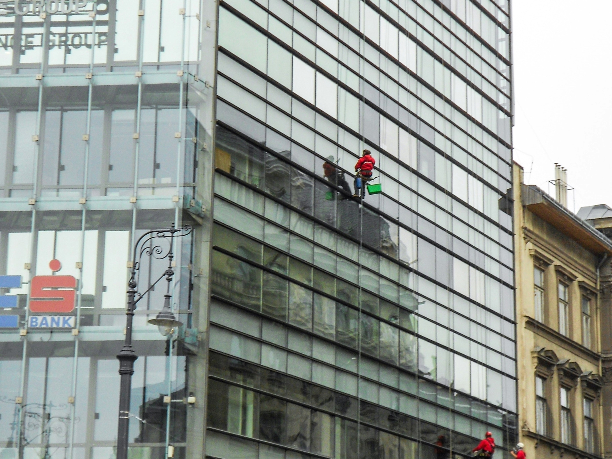 a photo of a window washers at work in budapest, hungary a photo by LensMomentsNS - Nichole Spates 2012