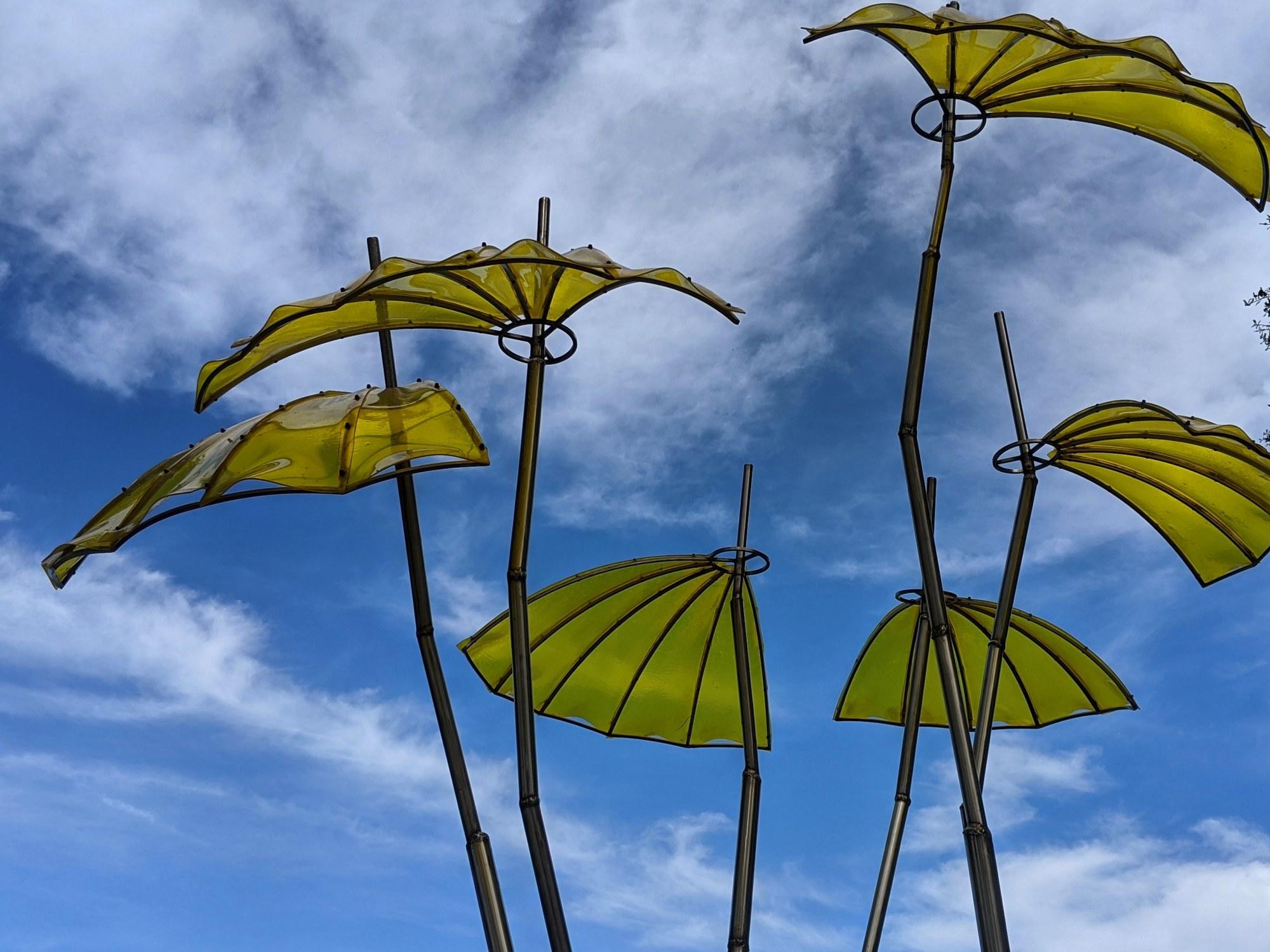 Sculpture against blue sky a photo by LensMoments - Nichole Spates 2020